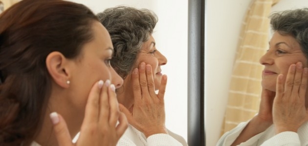 Picture of Older Woman Applying Cream